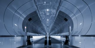 Symmetrical rings in subway tunnel Stock Photo