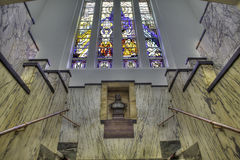 Symmetrical staircase. Symmetrical composition of marble stairs in the main hall of a fully decorated art deco building, a former brewery office in Breda, the Royalty Free Stock Images