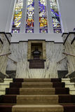Symmetrical staircase. Symmetrical composition of marble stairs in the main hall of a fully decorated art deco building, a former brewery office in Breda, the Stock Images