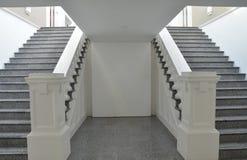 Symmetrical stairways. Symmetrical pattern of stairways found in the museum Royalty Free Stock Photos