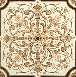 Symmetrical Tile. Antique aesthetic brown & cream symmetrical design tile c1880 Royalty Free Stock Images