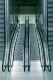 Symmetrical top view of four escalators going up and down. Escalators going up and down Royalty Free Stock Images