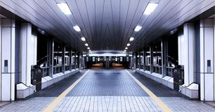 The symmetrical tunnel walkway across the road royalty free stock photography