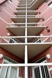 Symmetrical view of condominium balconies. Dramatic image of a new condo high rise with corner balconies Stock Images