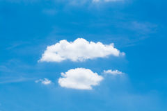 Symmetrical white clouds against the blue sky. Royalty Free Stock Images