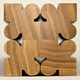 Symmetrical wood block pattern. Polished poplar wood ornate form photographed against a white background Royalty Free Stock Photos