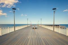 Symmetrical wooden pier in Kolobrzeg. With vintage effect Stock Photo