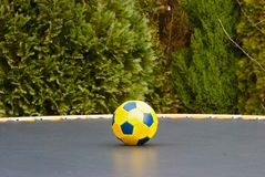 Symmetrically placed ball on a flat surface stock images
