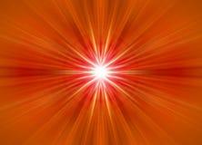 symmetrische orange Strahlen Stockbild