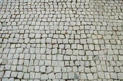 symmetriska former i cementpavers Arkivfoton