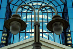 Symmetry. Detail from street lighting and glass exterior Kalca shopping center in Nis where the left and right sides foto almost identical. Picture taken 14.08 Royalty Free Stock Photo