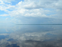 Symmetry on the Amazon. Symmetry water and sky on the Amazon river Stock Photos