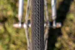 Symmetry Bicycle Tire. Close up Symmetry Bicycle Tire on Green Grass background royalty free stock image