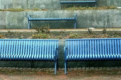 Symmetry on blue benches royalty free stock photo