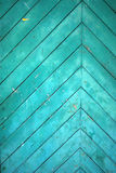 Symmetry door texture. Old turquoise symmetry door texture Royalty Free Stock Images