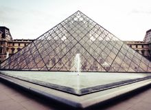 Symmetry of the glass pyramid. Glass pyramid at Louvre museum with water pond , Paris Stock Images