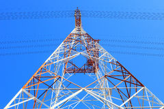Symmetry of high voltage electric power line tower metal structu Stock Photos
