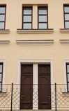 Symmetry house. Symmetry two brown wooden door with windows Stock Image