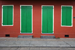 Symmetry: House Wall. Two doors and two windows of a house in New Orleans, Louisiana, USA Royalty Free Stock Photo