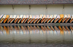 Symmetry of a line of boats. And their reflections in the water Royalty Free Stock Photos