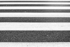 Symmetry of monochromatic parallel lines of crosswalk, asphalt rough pattern, no people stock photo