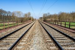 Symmetry railway in spring countryside under blue sky. Czech Republic, Europe. Vertical view in my portfolio too Royalty Free Stock Photo
