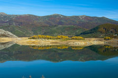 Symmetry reflected in water. Riaño dam, Spain Stock Images