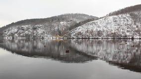 Symmetry winter landscape and yellow train. Near the Vltava river, Czech Republic stock video