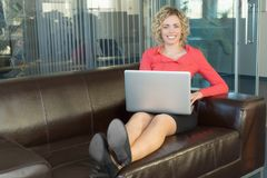 A sympathetic business woman. In a big office Stock Photography