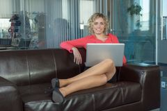 A sympathetic business woman. In a big office Stock Image