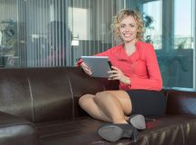 A sympathetic business woman. In a big office Royalty Free Stock Photography