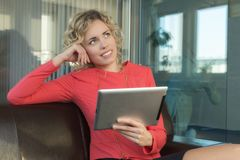 A sympathetic business woman. In a big office Royalty Free Stock Image