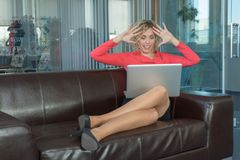 A sympathetic business woman. In a big office Royalty Free Stock Photo