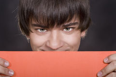 Sympathetic guy smiles royalty free stock photo