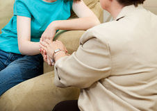 Sympathy. Depressed girl gets counseling and comfort from a caring therapist stock photos