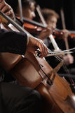Symphony concert. A men playing the cello, hand close up Royalty Free Stock Photo