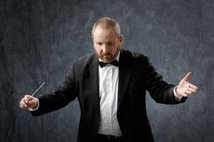 Symphony Conductor. Directing wiht a baton Stock Photos
