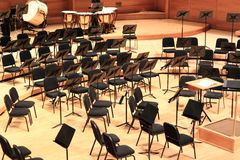 Symphony Orchestra. Stage before performance with empty chairs Stock Photo