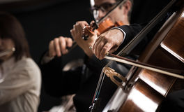 Symphony orchestra: cello player close-up Royalty Free Stock Photo