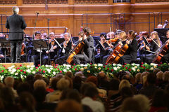 Symphony orchestra at Gala evening. MOSCOW - OCT 4: Symphony orchestra at Gala evening dedicated to the 100th anniversary of the All-Russian Museum Association Royalty Free Stock Photos