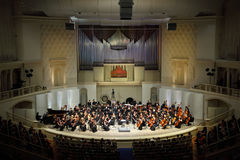 Symphony Orchestra of Moscow State Conservatory. MOSCOW - FEBRUARY 26: Symphony Orchestra of Moscow State Conservatory named after P. Tchaikovsky plays music in Royalty Free Stock Images