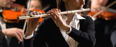 Symphony orchestra performance: flutist close-up Royalty Free Stock Images
