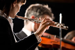 Symphony orchestra performance: flutist close-up Royalty Free Stock Photos