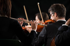 Symphony orchestra performance: flutist close-up Stock Photography