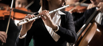 Symphony orchestra performance: flutist close-up Stock Images