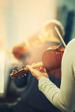 Symphony orchestra on stage. Hands playing violin royalty free stock photos