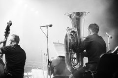 Symphony orchestra on the stage, tuba and double bass players, behind the scenes shoot in black and white royalty free stock images