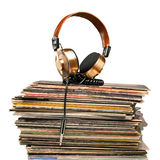 The symphony of soul. Golden headphones lying on the stack of vinyle records Royalty Free Stock Image