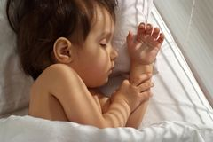 Sympothetic little girl sleeping at home Royalty Free Stock Photos