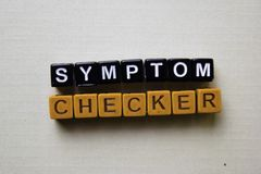 Symptom Checker on wooden blocks. Business and inspiration concept royalty free stock images